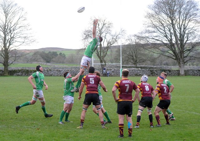 Out of action: The scene at Wharfedale's Threshfields ground in happier times, main and right, when rugby union was being played and the ground was a thriving hub of spectators, players family and friends. (Picture: Tony Johnson)