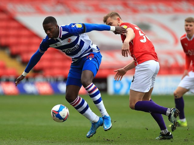 Reading's Lucas Joao nips in front of Barnsley's Michal Helik. Picture: PA