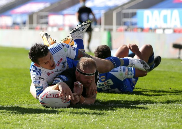 Castleford Tigers' Oliver Holmes scores his side's first try of the game against Leeds Rhinos at The Totally Wicked Stadium. Picture: Richard Sellers/PA