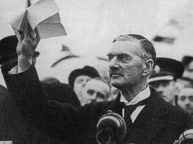 British prime minister Neville Chamberlain in 1938 with his 'piece of paper' ensuring peace in Europe. (Image: Shawshots / Alamy Stock Photo)