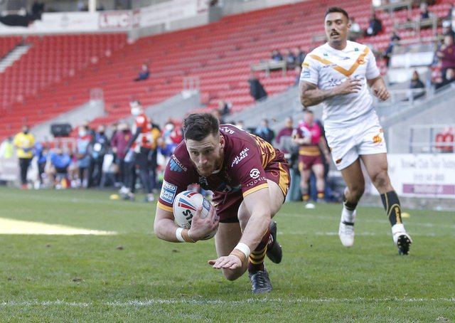 Second best:  Huddersfield Giants' Sam Wood scores their second try against Catalans. Picture by Ed Sykes/SWpix.com