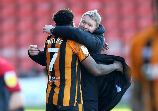 Joy: Hull City manager Grant McCann celebrates victory with Mallik Wilks. Picture: PA