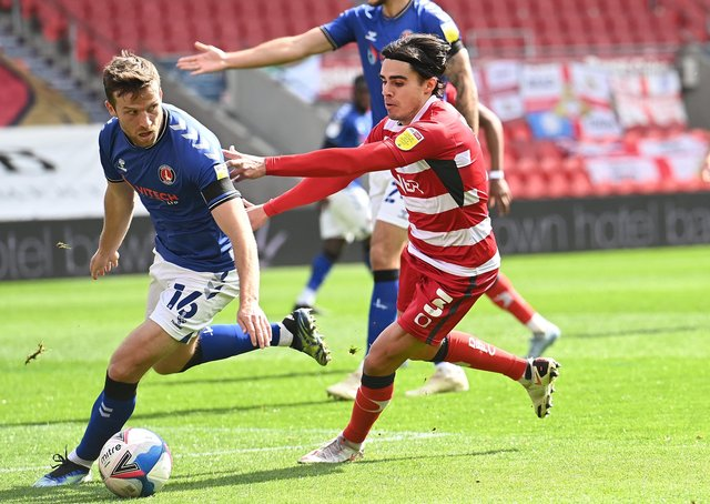 Determined:  Doncaster's Reece James chasing down the loose ball. Picture: Howard Roe