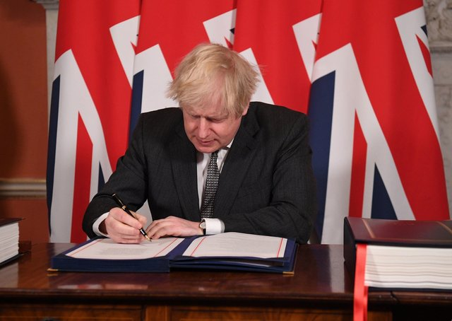 This was Boris Johnson signing the Brexit trade deal with the EU.