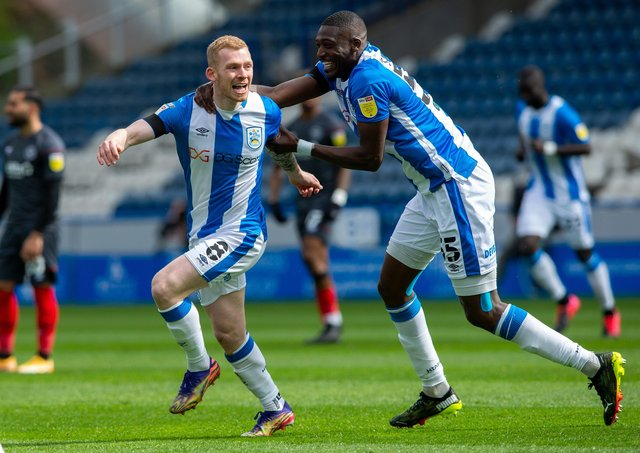 Up and running: Huddersfield Town's Lewis O'Brien, left, celebrates his goal against Brentford. Picture Bruce Rollinson