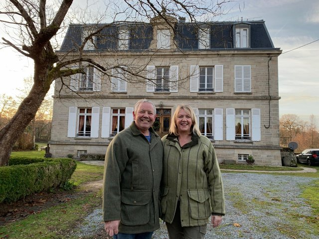 Debbie and Nigel ouside Chateau Gioux
