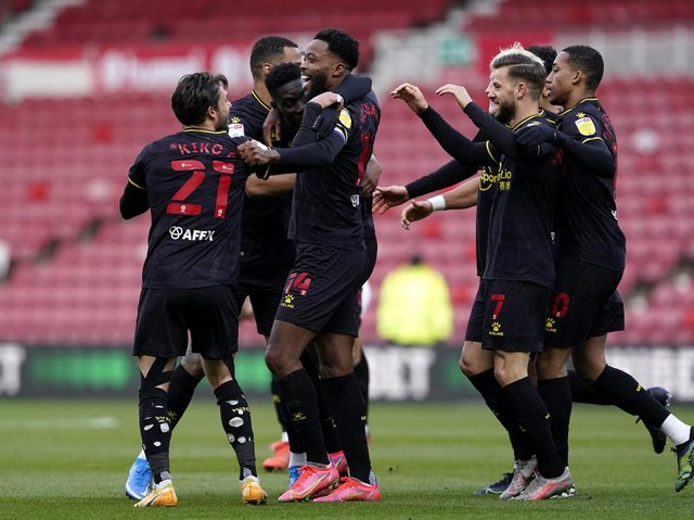 OPENER: Watford players celebrate after taking the lead at the Riverside Stadium. Picture: Owen Humphreys/PA Wire.