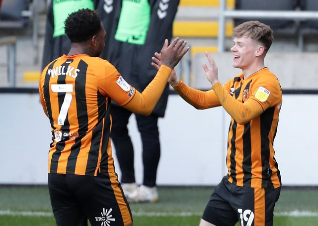 VICTORY: Hull City's Keane Lewis-Potter (right) celebrates scoring Hull's second goal of the game with team-mate Mallik Wilks. Picture: Richard Sellers/PA Wire.