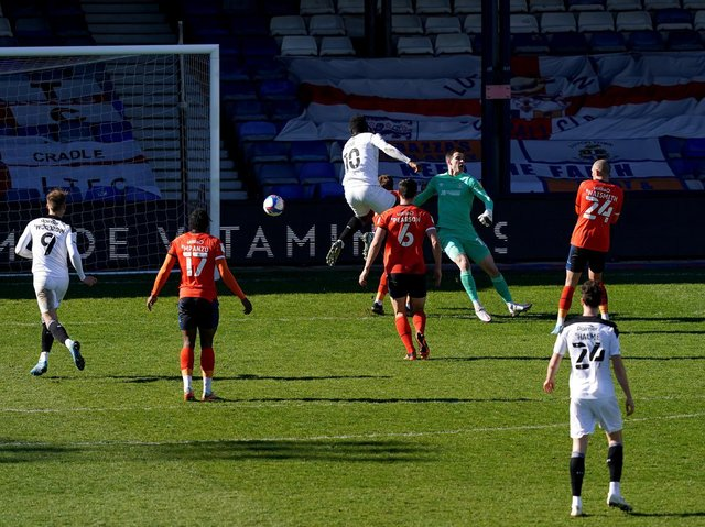 DECISIVE: Daryl Dike pokes home for Barnsley's second goal in their win over Luton Town. Picture: PA Wire.