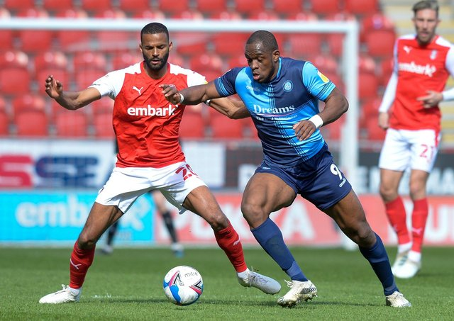 TOUGH GOING: Rotherham United's Michale Ihiekwe tangles with Wycombe's Uche Ikpeazu. Picture: Dean Atkins.