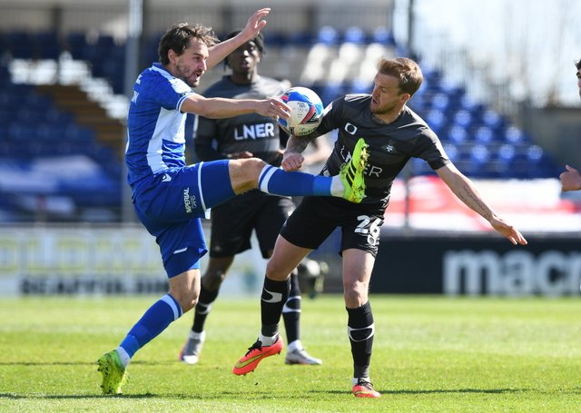 BAD DAY: Doncaster Rovers' James Coppinger tussles with BristolRovers' Ed Upson. Picture Howard Roe/AHPIX LTD,