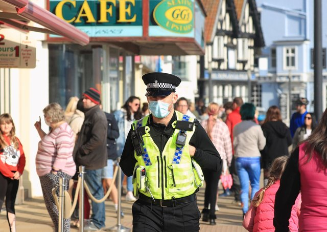 A police officer patrols the seafront in Scarborough as the region prepares for the next PCC elections.