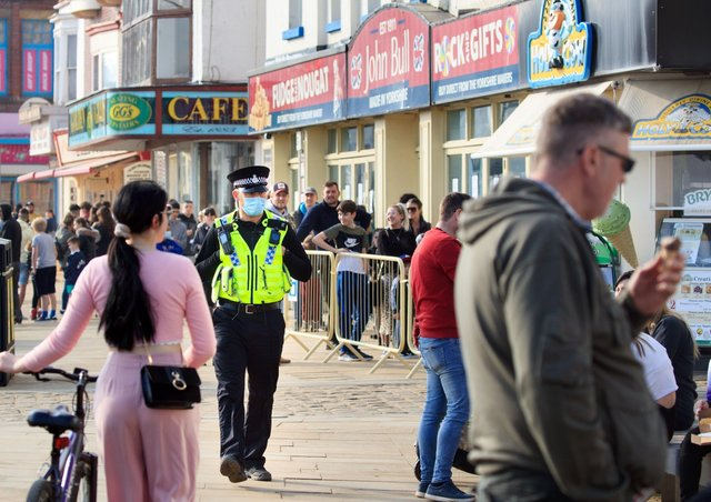 A police officer patrols Scarborough's seafront as the lockown is eased.