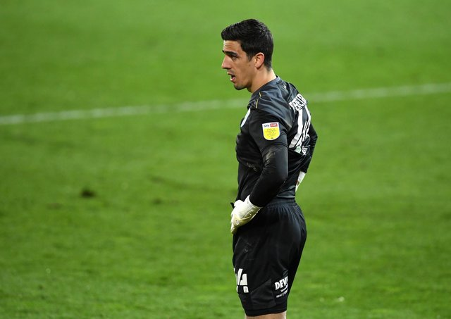 Night to forget: Huddersfield Town goalkeeper Joel Pereira was a late call-up for the ill Ryan Schofield and conceded seven on only his second start. Picture: Joe Giddens/PA Wire.