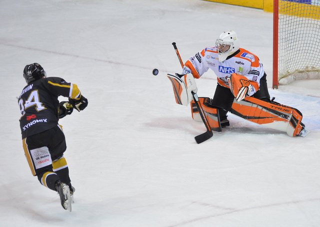 NOT TONIGHT: Ben Churchfield turns away Christophe Boivin's penalty shot for Nottingham Panthers in the 57th minute to enable Steelers to prevail 3-2. Picture courtesy of Dean Woolley.