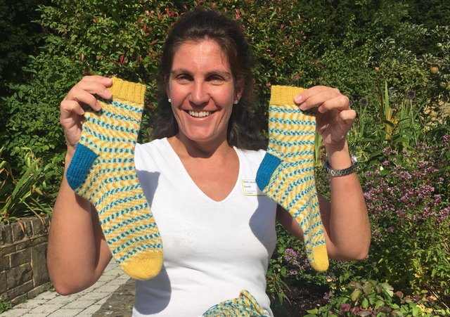 Dr Sarah Holmes who raised £50,000 by running and knitting for Marie Curie