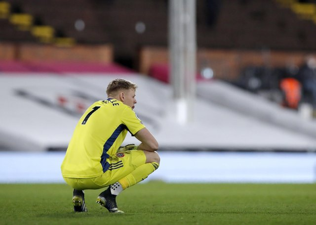 TOUGH TIMES: Sheffield United goalkeeper Aaron Ramsdale crouches dejected during the Premier League match at Craven Cottage. Picture: Andrew Couldridge/PA