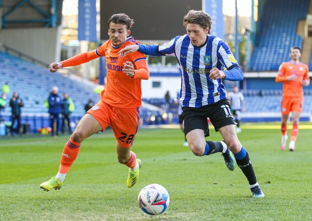 Sheffield Wednesday's Adam Reach (right) and Cardiff City's Tom Sang battle for the ball at Hillsborough on Monday. Picture: Isaac Parkin/PA