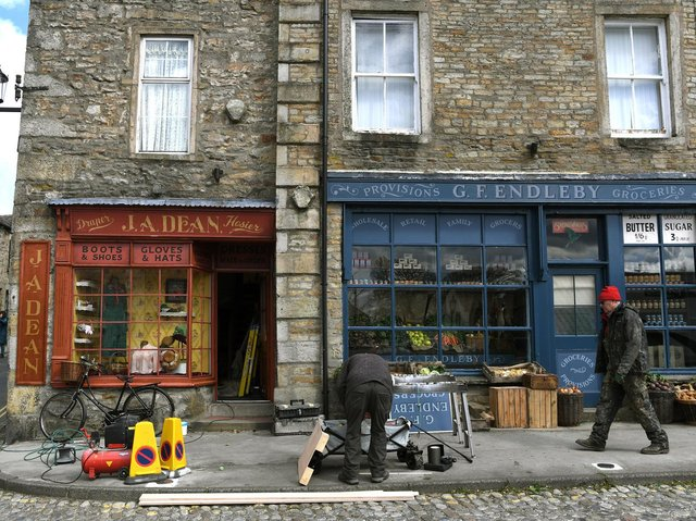 Two of Grassington's shops have become a greengrocer's and a hosier's