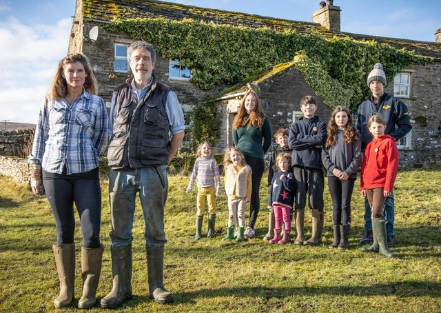 Amanda and Clive Owen with their children Annas, Clemmy, Raven, Sidney, Nancy, Miles, Edith, Violet and Reuben outside Ravenseat Farm. Photo: Renegade Pictures.