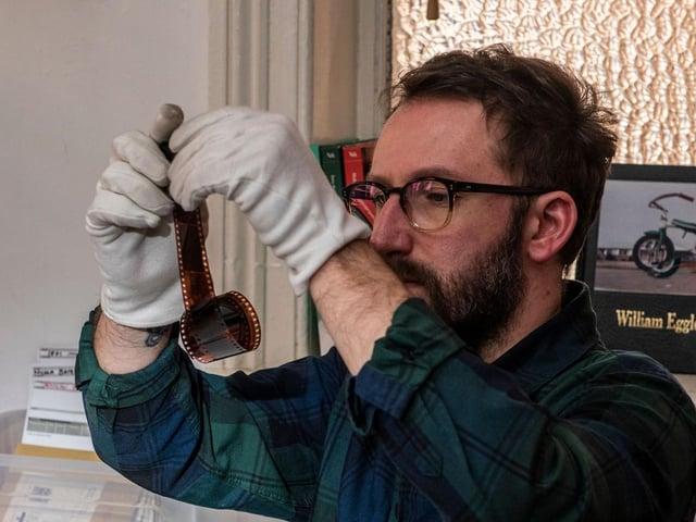 Liam Henry checking negatives. Picture: Ernesto Rogata.
