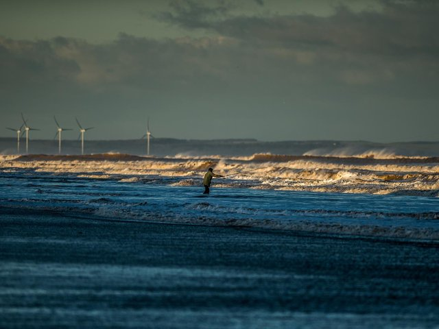 A fisherman braves the bitterly cold Yorkshire Coast weather to cast his line out to sea on the shores of Hornsea. Picture: James Hardisty.