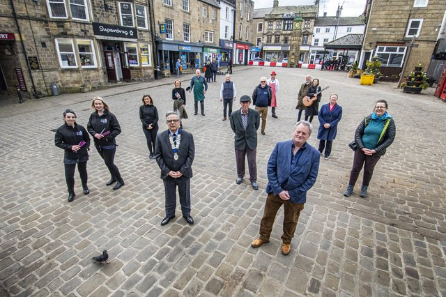 Simon Raybould, chair of Otley Chamber of Trade and Commerce, front left with  Paul Carter, chair of Otley Town Council's trade and tourism committee, front right,  joined by traders in the West Yorkshire town as they prepare to reopen their doors.   Picture: Tony Johnson