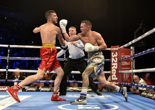 TOP OF THE WORLD: Josh Warrington gets in a last big punch on Sofiane Takoucht  before the referee moves in to stop the fight at Leeds Arena in October 2019. Picture: Steve Riding.