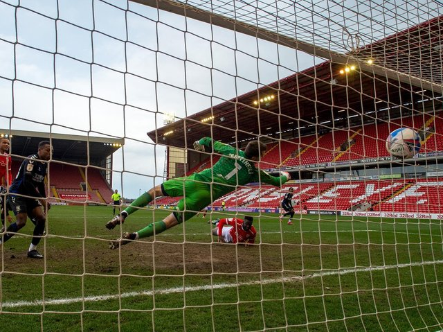 Daryl Dike scores Barnsley's second goal versus Middlesbrough. PICTURE: BRUCE ROLLINSON.