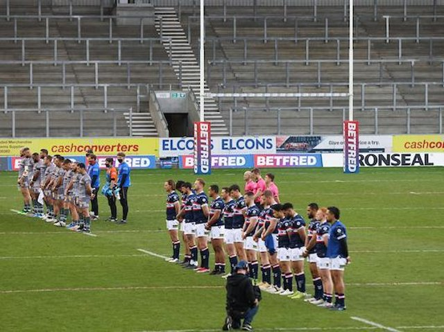 The sides stand for a minute's silence in memory of the Duke of Edinburgh before Catalans' Cup win over Trinity. Picture by SWpix.com