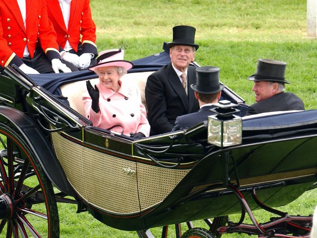 The Queen and Prince Phillip are pictured during the Royal Procession on the first day of Royal Ascot at York, in June 2005. The famous festival was held at York Racecourse while Ascot was refurbished (Picture: AFP via Getty Images).