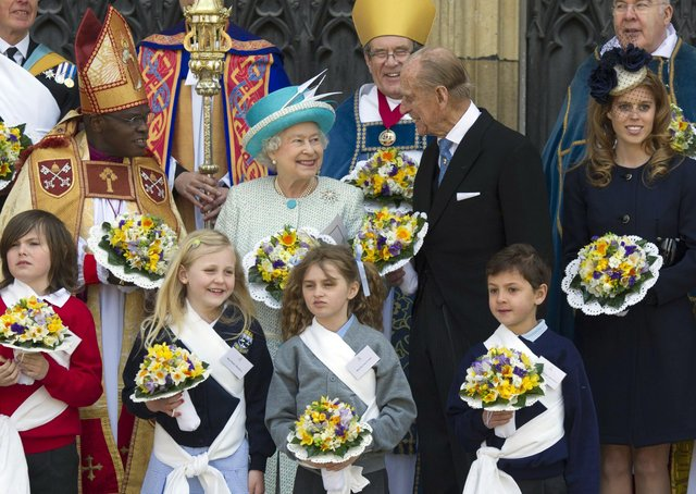 The Queen and Prince Philip with Dr John Serntamu, the then Archbishop of York, during the 2012 Maundy Thursday service at York Minster.