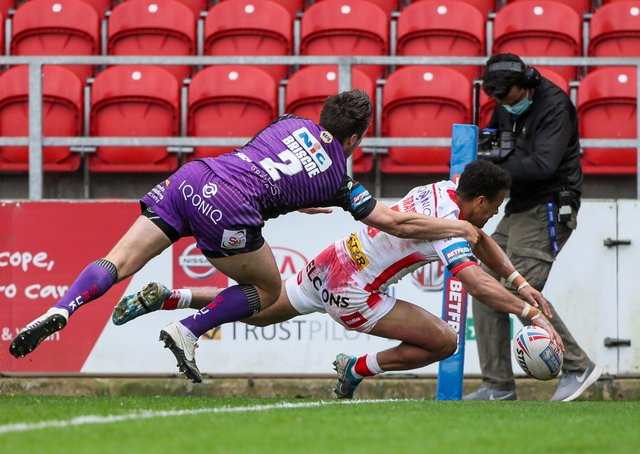 In the corner: St Helens' Regan Grace scores against Leeds Rhinos. Picture by Alex Whitehead/SWpix.com