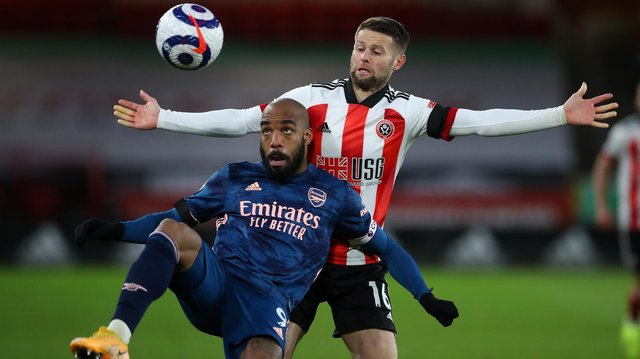 GOALSCORER: Alexandre Lacazette, shielding the ball from Oliver Norwood, put Arsenal in front