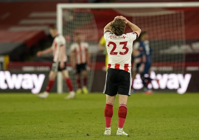 Sheffield United's Ben Osborn looks on dejected in defeat to Arsenal. Pictures: Andrew Yates/Sportimage