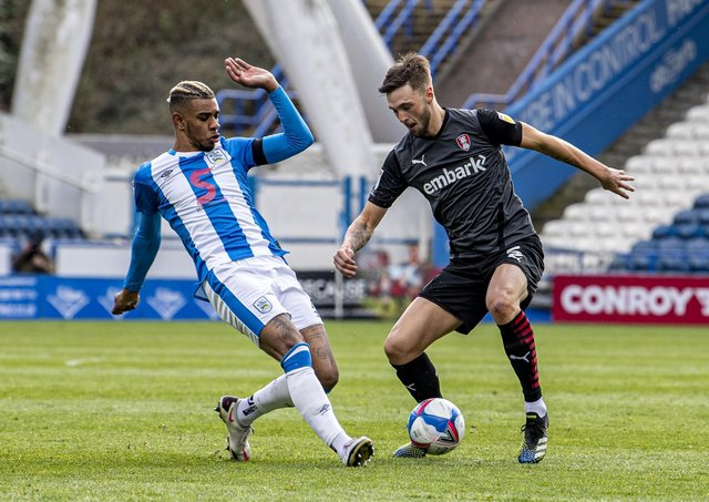 Huddersfield Town's Juninho Bacuna challenges Millers' Lewis Wing. Picture Tony Johnson