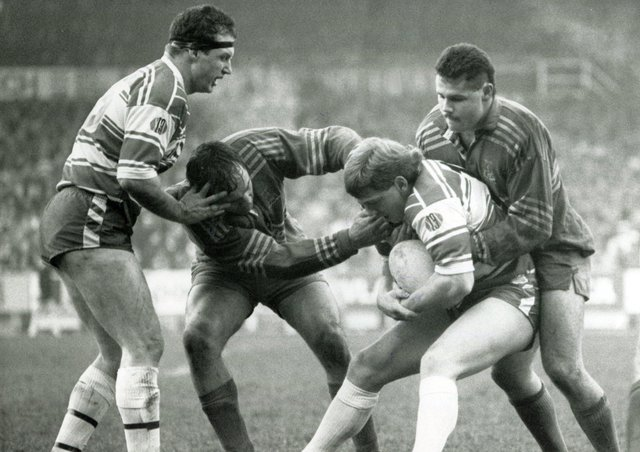 Doncaster's Graham Idle and Carl Hall (right) combine to stop Wigan's progress during their Cup tie at Central Park, January 1990.