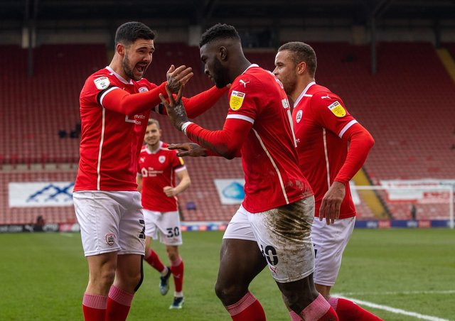 Winners: Daryl Dike celebrates his goal with Alex Mowatt. Pictures: Bruce Rollinson