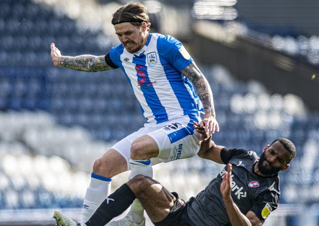 Terriers' Danny Ward and Millers' Michael Ihiekwe challenge for the ball.  Pictures: Tony Johnson
