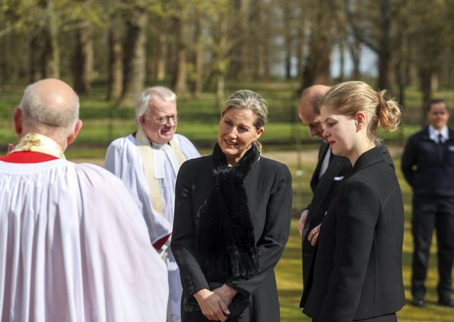 The Earl and Countess of Wessex, with their daughter Lady Louise Windsor, talk to Cannon Martin Poll, Domestic Chaplin to Her Majesty The Queen, as they attend the Sunday service at the Royal Chapel of All Saints at Royal Lodge, Windsor, following the announcement on Friday April 9, of the death of the Duke of Edinburgh at the age of 99.