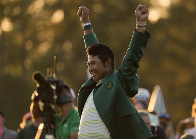 Champion: Hideki Matsuyama celebrates his Masters win. Picture: AP Photo/Charlie Riedel