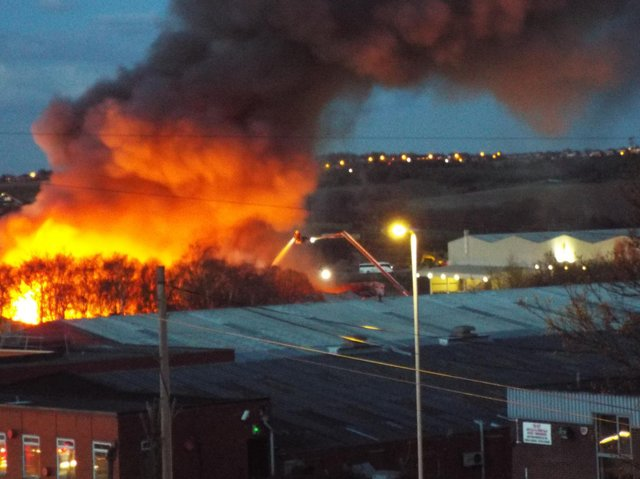 West Yorkshire Fire and Rescue Service have sent eight crews to the scene and are urging residents to keep windows and doors shut. People are also advised to avoid travelling through the area.
