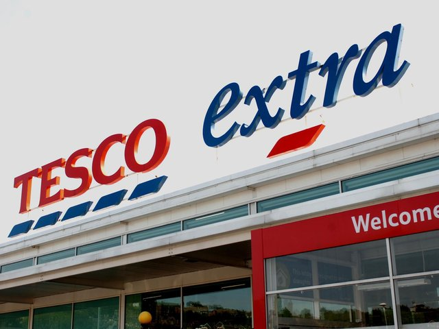 Tesco said pre-tax profits tumbled to £825m over the past year.