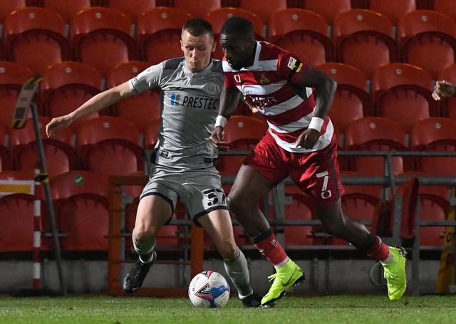 Doncaster's Omar Bogle battles with Burton's Tom Hamer. Picture: Andrew Roe/AHPIX