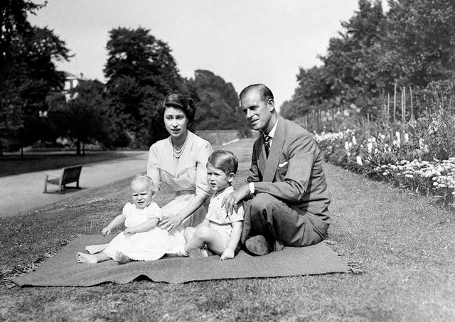 A touching photo of then Princess Elizabeth and Prince Philip, with Prince Charles and Princess Anne, in 1951.