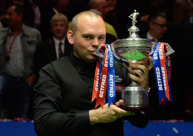 Stuart Bingham celebrates with the trophy after winning the 2015 Betfred World Championship. Picture: Anna Gowthorpe/PA Wire