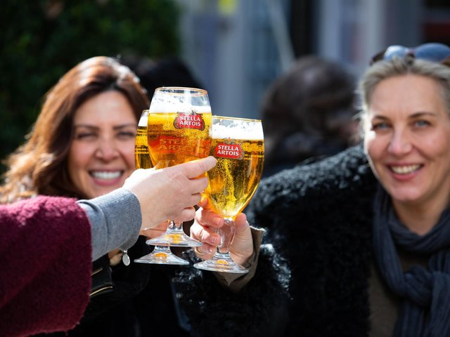 Friends enjoy a pint of Stella Artois amid the return of customers to the hospitality sector, following the latest lifting of restrictions. Photo: PA