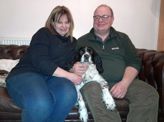 Bailey with his owners