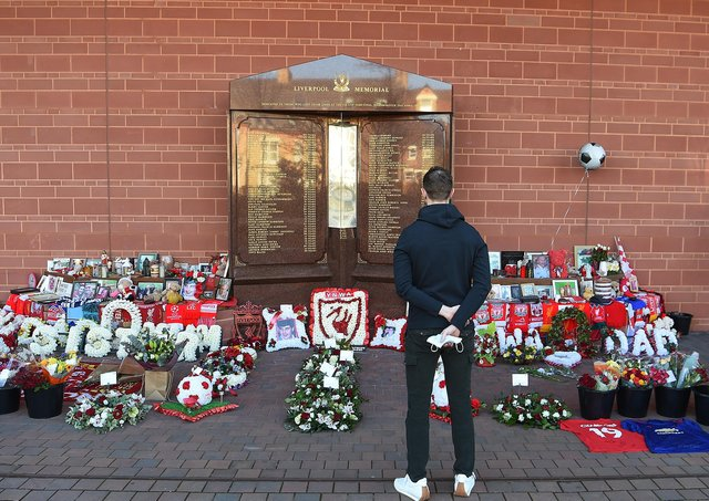 Jordan Henderson pays his respects at the Hillsborough memorial outside Liverpool Football Club's Anfield ground.