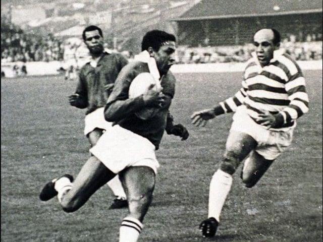 Clive Sullivan with the ball, centre, alongside Billy Boston and Colin Dixon.